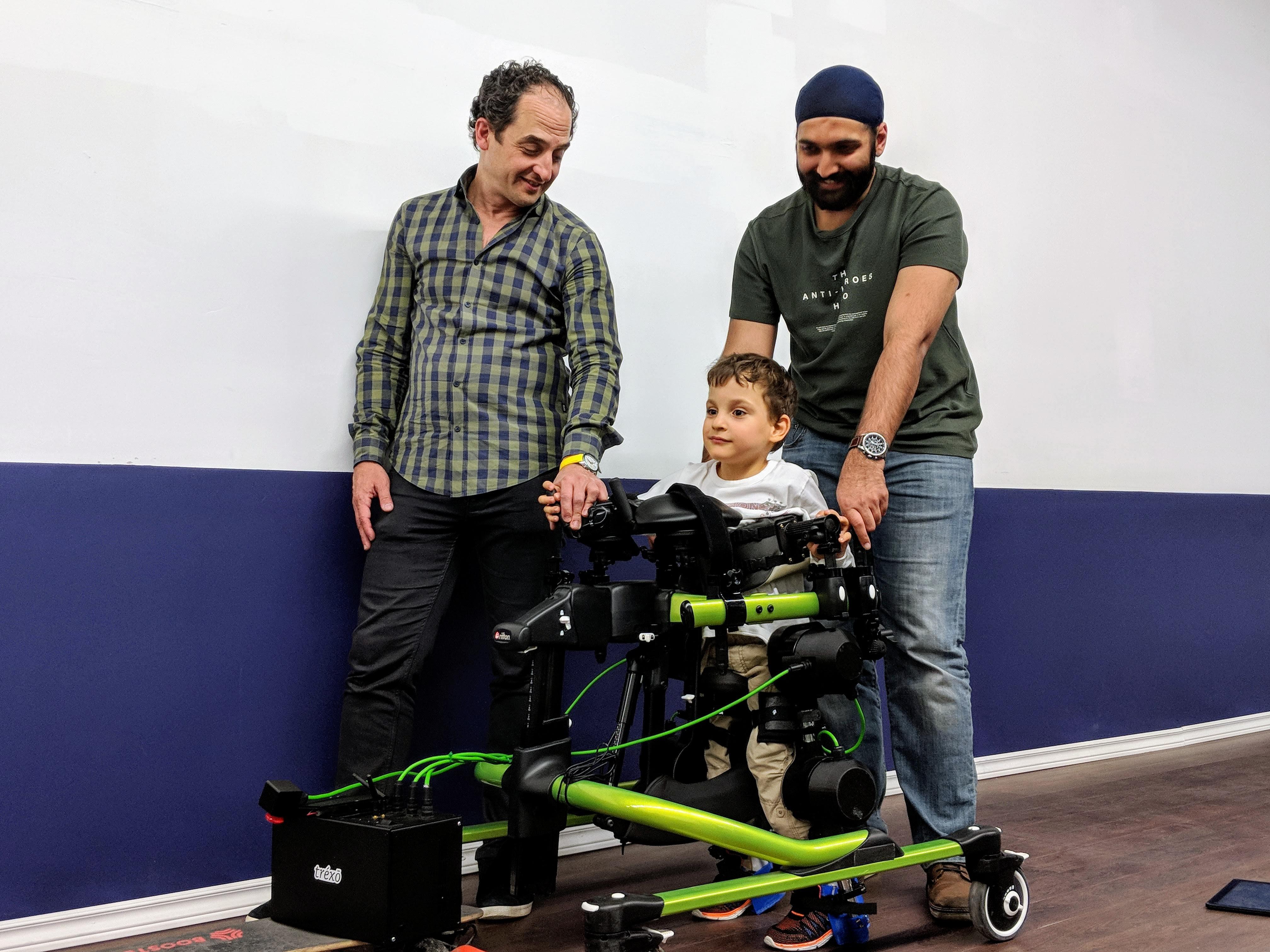 Boy using Trexo for cerebral palsy rehabilitation