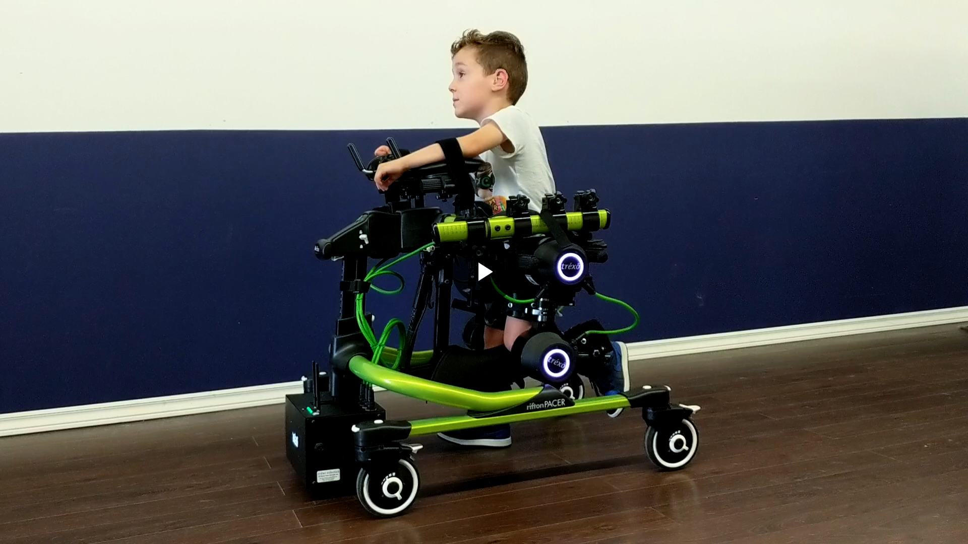 Boy walks with assistive device, Trexo Plus